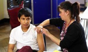 A nurse giving a vaccination
