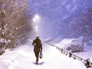 A man walks through a blizzard in central Murmansk