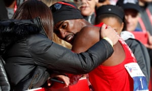 Mo Farah is consoled after only finishing eighth in the Chicago marathon in his his worst time at the distance.