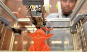 A 3D printer creates a Yoda toy