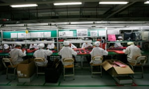Workers are seen inside a Foxconn factory in the township of Longhua, in China's Guangdong province.