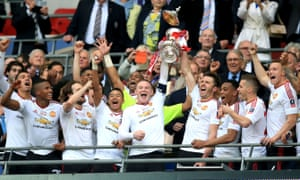 Manchester United's Wayne Rooney (left) and Michael Carrick (right) lift the FA Cup trophy.