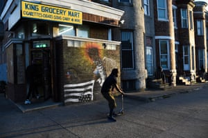 """Baltimore street artist SORTA's North Avenue mural titled """"justice"""", is based on a JM Giordano photo of a protester at the Western District police station during the protest following Gray's death"""