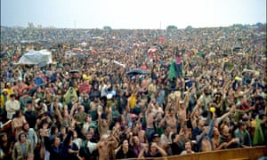photo by Elliott Landy shows the crowd at the original Woodstock festival in Bethel, New York in August 1969