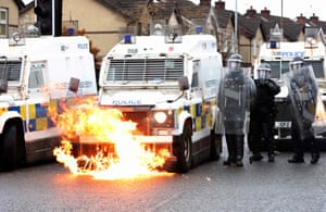 Flames lick up the front of a police vehicle as police officers are attacked by nationalist youths in the Springfield Road area. Rioting over the last few days -- the city's worst unrest in recent years -- had mainly stemmed from its unionist community, who are angry over apparent economic dislocation due to Brexit and existing tensions with pro-Irish nationalist communities.