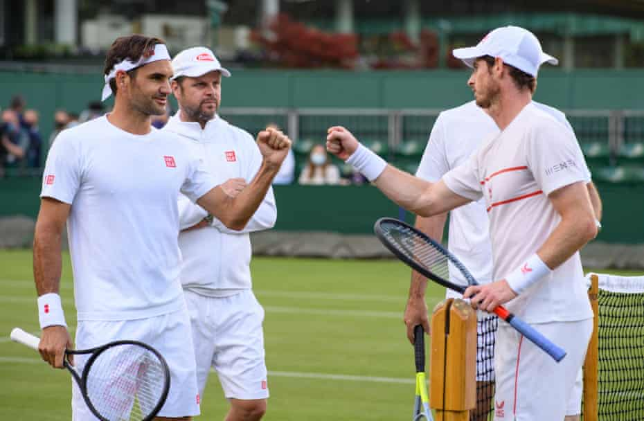 Roger Federer (left) and Andy Murray bump fists after a practice session on Court 14 ahead of The Championships.