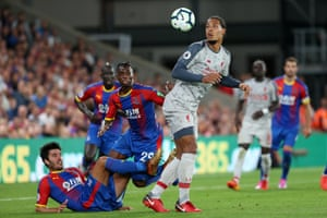 Virgil van Dijk of Liverpool battles with Aaron Wan-Bissaka of Palace (C) and James Tomkins of Palace