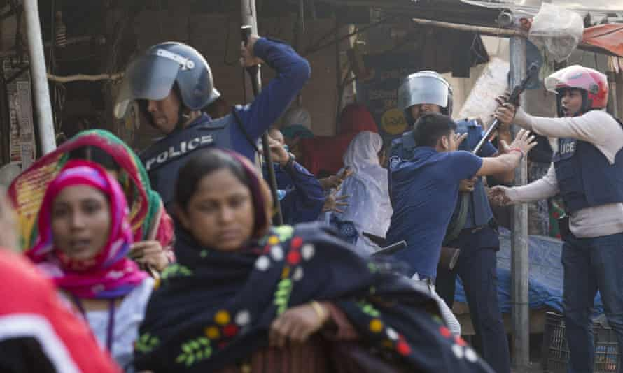 Bangladesh garments worker clash with police during demonstration to demand wage rises in Dhaka on Sunday.