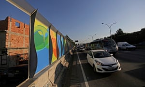 Banners advertising the 2016 Rio Olympics near Maré on the Linha Vermelha freeway connecting Galeão airport with Rio's downtown and south Zone.