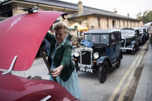 Re-enactors prepare to take part in a wartime vehicle parade.