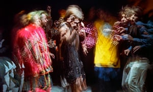 A time-exposure view of dancers under the influence of LSD.
