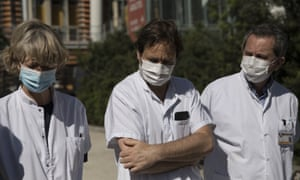 Medical staff speaking outside La Timone hospital in Marseille after a boy died of Kawasaki disease.