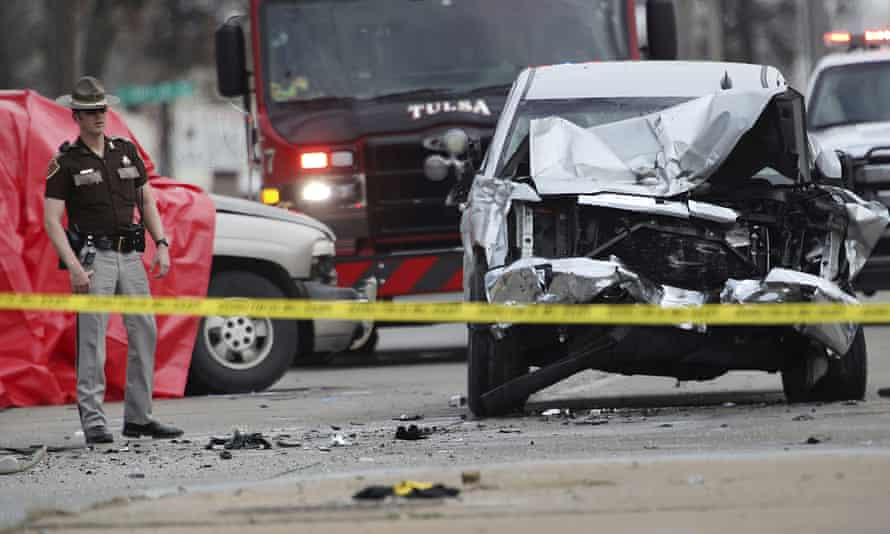 Law enforcement personnel work the scene of a crash on 25 February 2021, in Tulsa, Oklahoma.