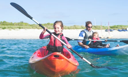 Family kayaking off the Isles of Scilly