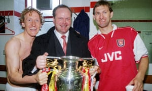 Steve Rowley, then scouting for Arsenal, celebrates the club's Premier League title win in 1998 with Ray Parlour (left) and Tony Adams.