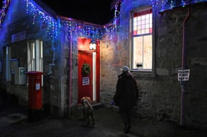 A dog leads the way to a polling station in Furnace, near Inveraray
