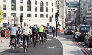 Cyclists on segregated cycle lane in London