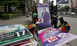 Workers load campaign billboards displayed to promote candidates for last month's general election into a truck in Bangkok, Thailand.