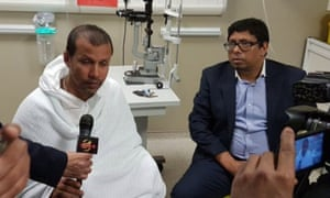 One of the victims of the acid attacks, delivery driver Jabed Hussain, left, with Ohid Ahmed of Tower Hamlets council.