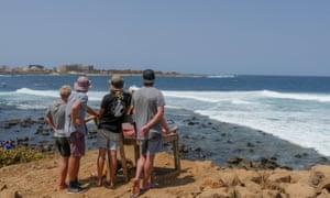 Surf fans watch the men's heats in the Senegal Pro