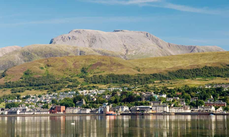 Ben Nevis, highest mountain in UK, rises above Fort William at the head of Loch Linnhe. Western Highlands, Scotland. Summer. UK