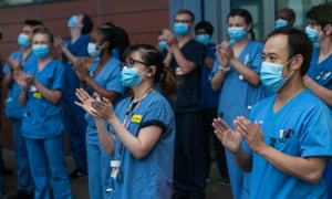 Local people and NHS workers applaud key workers at Royal London Hospital in East London