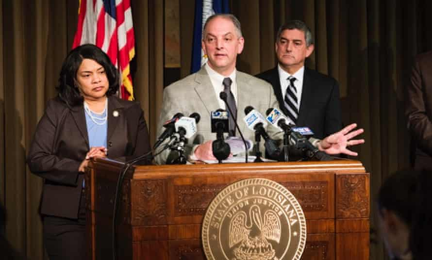 Governor John Bel Edwards (center) making his budget announcement,