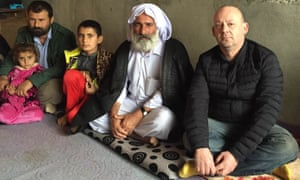 Giles Fraser with a Yazidi family in northern Iraq