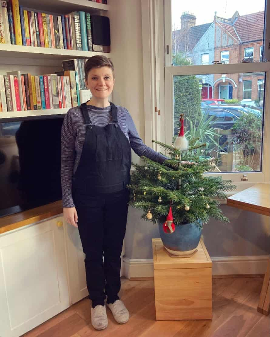 Picture of Kate Green by a Christmas tree.