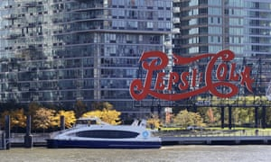 A water taxi approaches the Long Island City waterfront and high-rise luxury apartment buildings on 7 November.