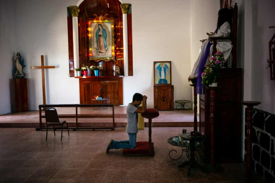 A migrant prays at a church in the town of Huixtla, Chiapas state, Mexico.