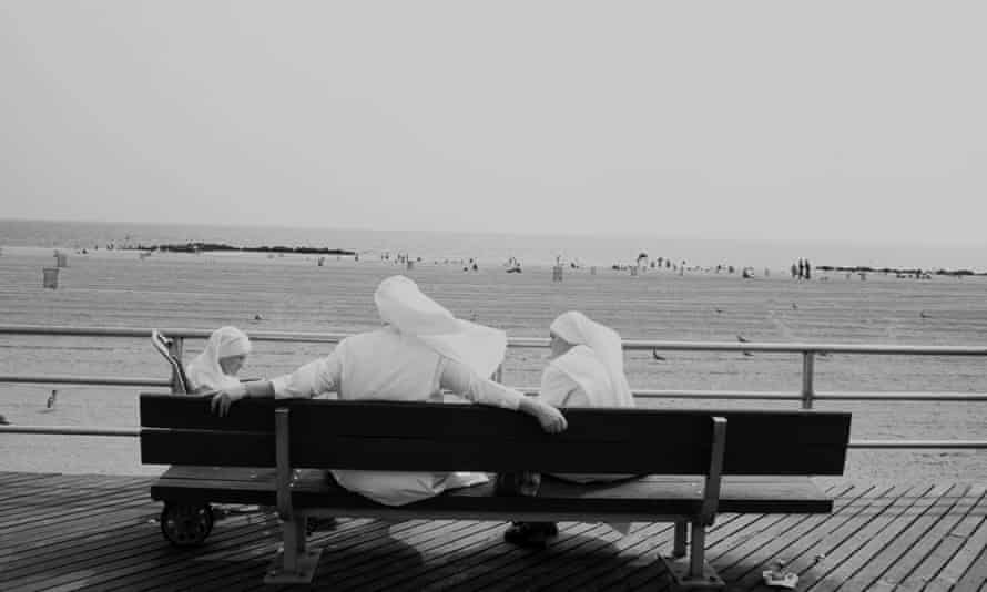 Quiet moments … nuns at Coney Island, Brooklyn. Photograph: Alamy