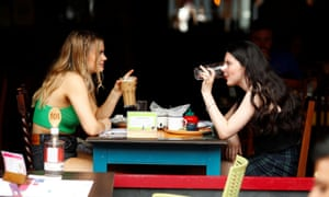 Two women sharing an outdoor meal in didsbury, manchester