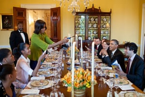 Michelle Obama lights candles during a Seder at the White House in 2012.