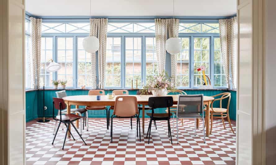 Square vision: the dining room features mismatched chairs collected over the years.