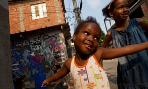 Children play in the favela complex of Mare, where promised improvements include the municipal Schools of Tomorrow project offering children a full-day in school and better facilities.