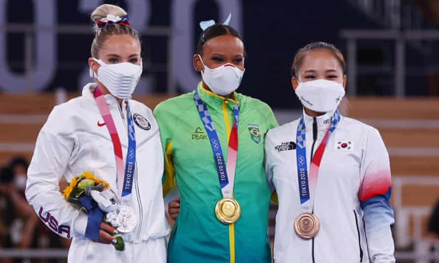 The vault gold medallist Rebeca Andrade of Brazil celebrates on the podium with the silver medallist, Mykayla Skinner of the USA, Yeo Seojeong of South Korea who won bronze.
