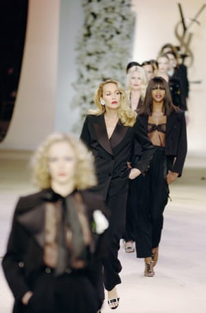 Jerry Hall and Naomi Campbell displaying Yves Saint Laurent in 2002.