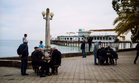 Local men playing chess and backgammon on Sukhumi's central promenade.