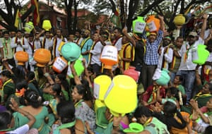 Protesters carry empty pots of water to campaign against a recent supreme court order on a water-sharing dispute, in Bengaluru, in the southern Indian state of Karnataka