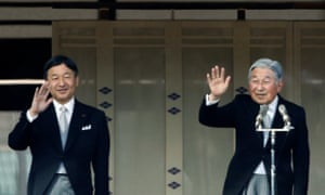 Japanese Emperor Akihito and Crown Prince Naruhito wave to well-wishers during a public appearance for New Year celebrations at the Imperial Palace in Tokyo.