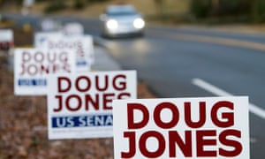 Signs supporting Doug Jones line a road in Mountain Brook, Alabama on Tuesday.
