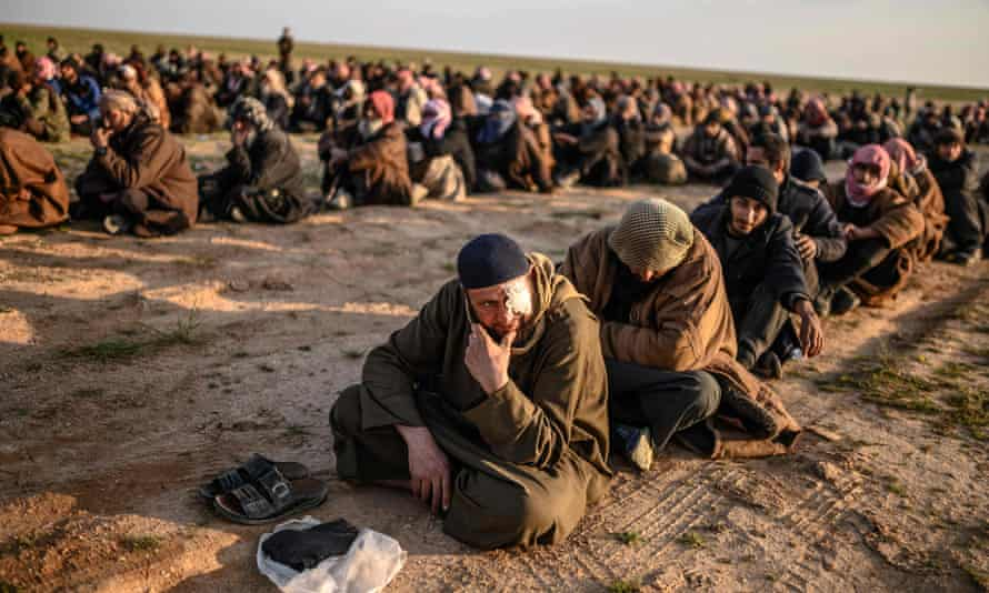 Men suspected of being Isis fighters captured by the Kurdish-led Syrian Democratic Forces in group's last holdout of Baghouz in March 2019
