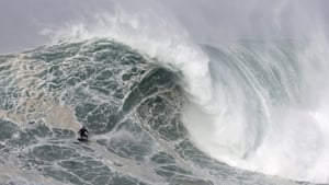 Germany's Sebastian Steudtner rides a wave during a tow surfing session at Praia do Norte.