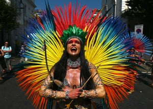A performer takes part in a parade at Notting Hill carnival