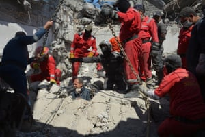 Iraqi firefighters look for bodies and possible survivors buried under the rubble after an airstrike against Isis triggered a huge explosion