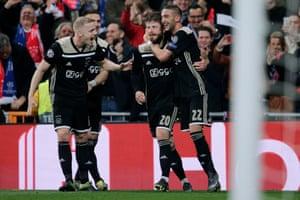 Lasse Schone is congratulated by Donny van de Beek (left) and Hakim Ziyech (right) after scoring Ajax's fourth goal.