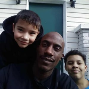 Carlos Carson with his two sons.