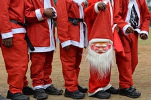 Schoolchildren dressed as Santa Claus in Chennai, India