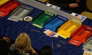 Count volunteers sort ballot papers at Kensington town hall, London